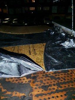 Emergency roof repair at night